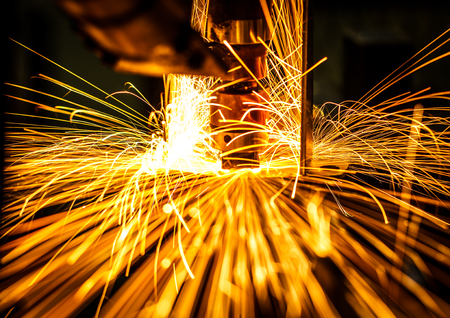 Motion Welding robots in a car factory with sparks, manufacturing, industry, factory Stock Photo