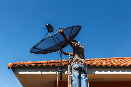 Technicians install satellite signal with the beware
