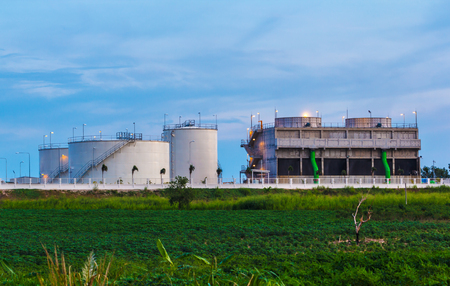 Petrochemical oil refinery plant with blue and of a power plant in a beautiful evening. Stock Photo