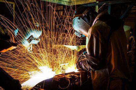 worker good welding technician in the automotive industry.