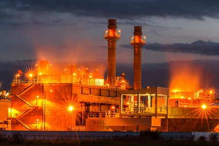 Petrochemical oil refinery plant with blue and Twilight image of a power plant in a beautiful evening
