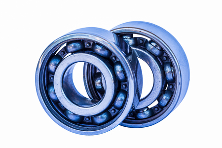 Half-ball bearings isolated from white background.