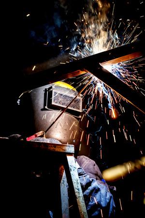 worker with protective mask welding metal industrial Imagens