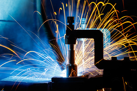 The arm of a welding robot moves with speed.