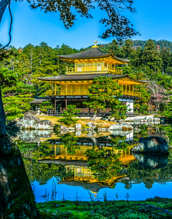 Kinkakuji Temple beautiful architecture with natural light in the morning in Kyoto, Japan. Редакционное