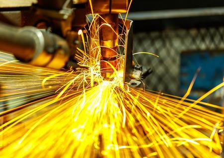 Spot machine is welding nut to automotive part