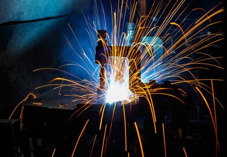 Roboot welding circular automotive parts.