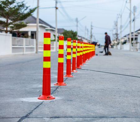 Orange traffic cones in the outdoors, alert, beware