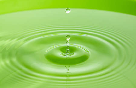 Green water wave and bubbles to clean drinking water