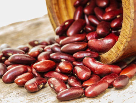 Photos of beautiful close-up red beans on a white background.