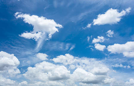 The sky with a beautiful white cloud is moving with the wind.