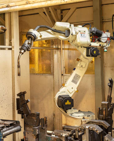 Industrial welding robots in the automotive parts production line in Thailand factories