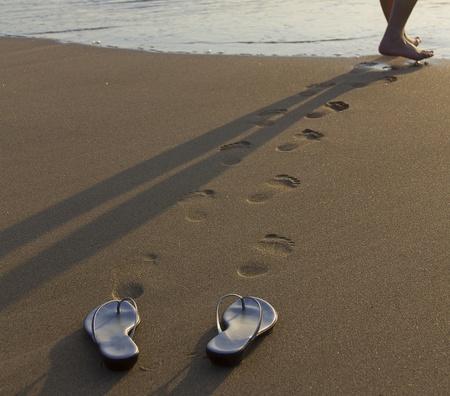 waikiki beach: Photo session of model walking into the pacific Ocean at Waikiki Beach during evening.