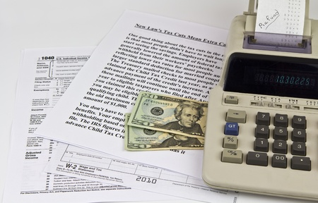 Tax forms, old calculator, w2, US Currency and IRS Tax Updates photo