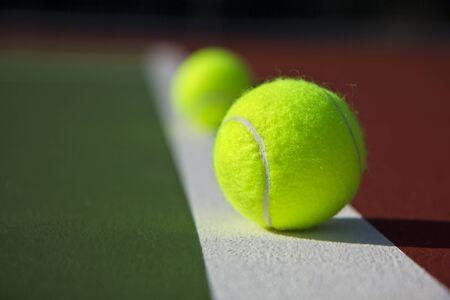 New Tennis Balls shot on  a brand new outdoor tennis court photo