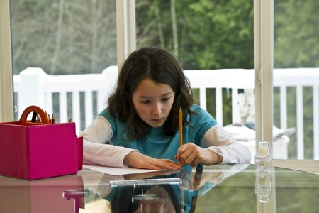 left handed: Young Left Handed artist drawing on glass table Stock Photo