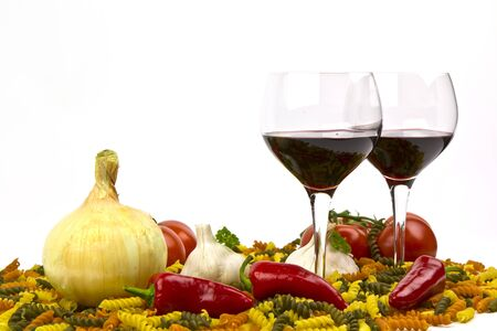 Red Wine, Wine Glasses, Red Peppers, Onion, Tomatoes, Colorful Raw Pasta, Garlic and Parsley photo