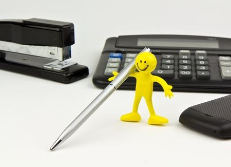 office stapler: Office equipment- pen, stapler, calculator, and cell phone