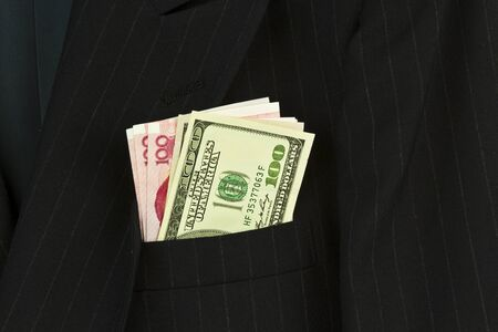 Mens business suit and money Stock Photo