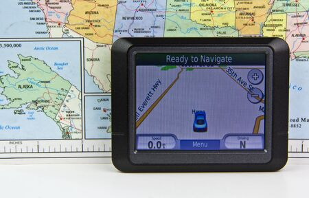 Modern mobile GPS unit and map photo