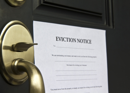 Eviction notice letter posted on front door of house photo