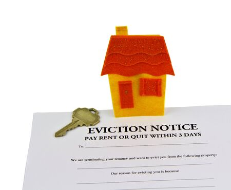 Eviction notice paper, house key, and small house  photo
