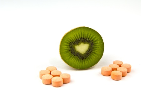 Half kiwifruit with Vitamin C tablets