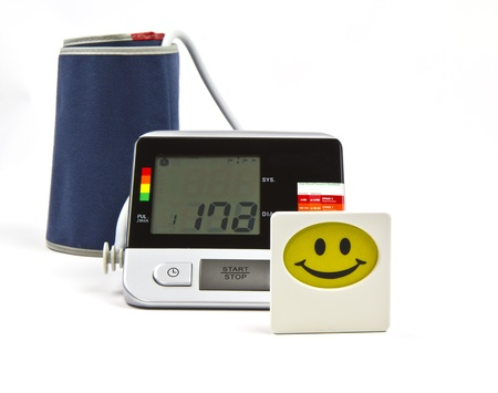 Blood pressure monitoring device with happy smile figure photo