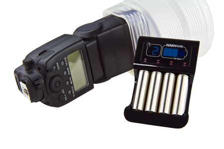 Modern battery charger, NiMH batteries, and camera flash with diffuser  photo