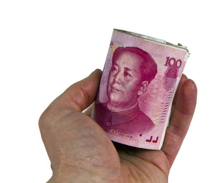 yuan: Chinese Yuan roll in hand on White background