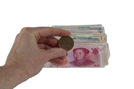 Rare Chinese coin and paper money in background photo