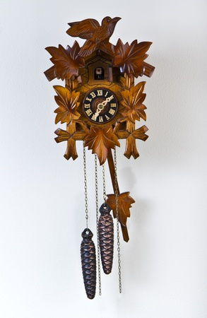 Family cuckoo clock with metal pine cones