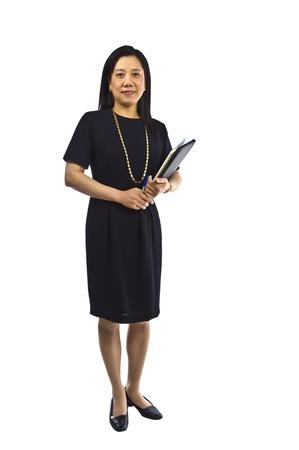 アジアの女性教師が白い背景で撮影