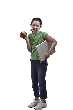 Young girl snacking on her apple with white background photo