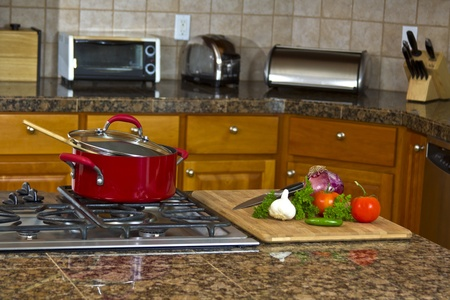 Kitchen stove top with sauce pan