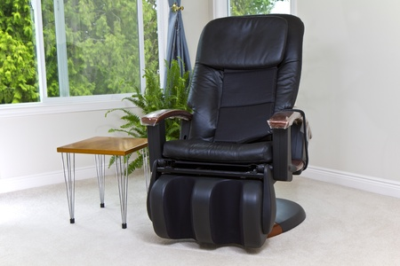 comfortable chair: Massage chair in house with windows open Stock Photo