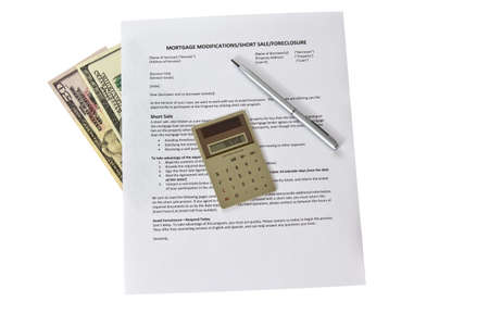 Mortgage modification form with calculator and pen on white background photo