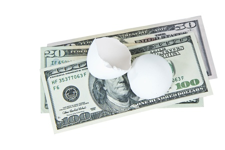 nestegg: Broken egg shell with paper money on white background