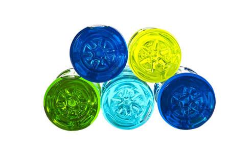 replenish: Backside of colorful water bottles on white background Stock Photo