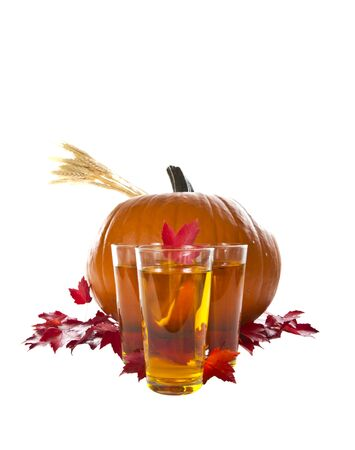 large pumpkin: Large pumpkin with drinks and red maple leafs on white background