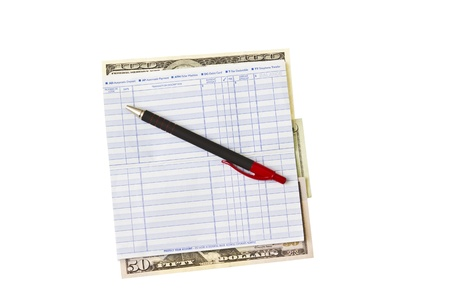 bank records: Clean Checkbook with pen and money on white background