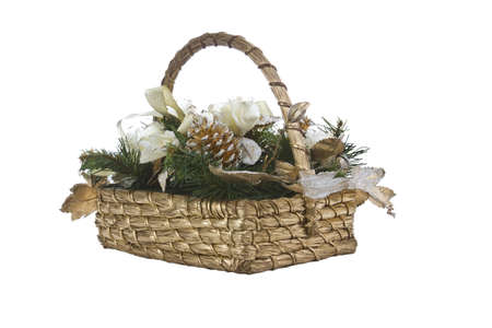 Wicker basket with ribbons, evergreen and pine cones on white background photo