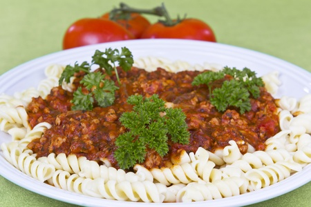 home grown: Fresh home grown parsley on top of red sauce pasta Stock Photo