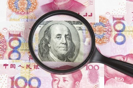 rmb: United States paper currency under magnifying glass with Chinese currency as background Stock Photo