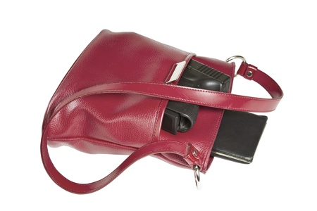 concealed: Personal weapon in red purse on white background
