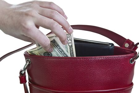 thievery: Money being taken out of red purse on white background