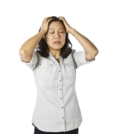 Asian women expressing frustration dressed in casual work clothing on white background