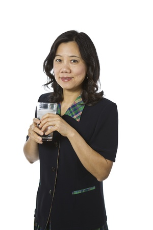 Asian women with glass of ice water, wearing dark business outfit on white background Stock Photo - 12178487