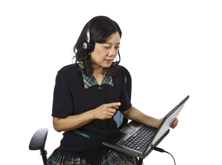 Asian women with headset, laptop and office chair on white background Stock Photo - 12178483