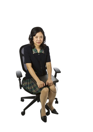 Asian women sitting in office chair with notebook and headset on white background Stock Photo - 12178480